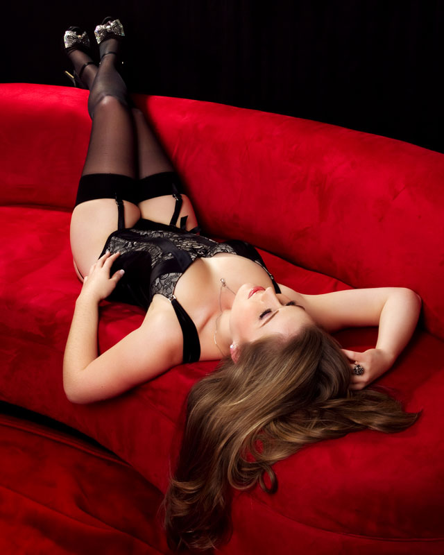 sexy boudoir on red couch