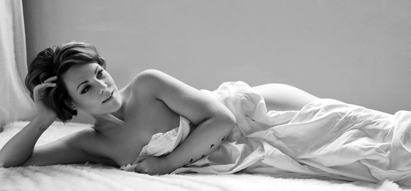 Nude under the sheets, is she nervous?